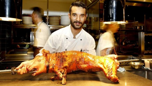 Head chef Robert Taylor with a suckling pig.