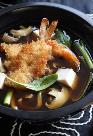 Udon noodle soup with crumbed prawn cutlets.