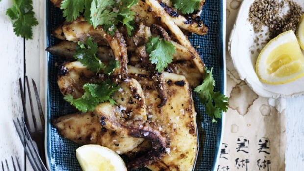 Miso-glazed squid stakes are best washed down with sake.
