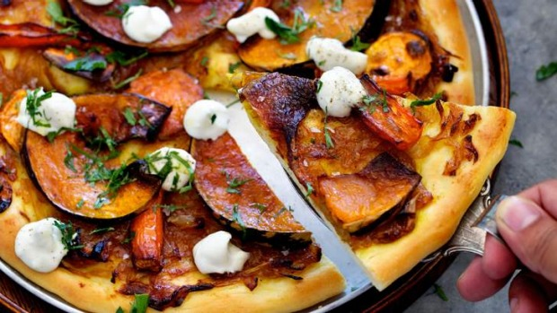 Leftover roast vegies are put to good use as a pizza topping.