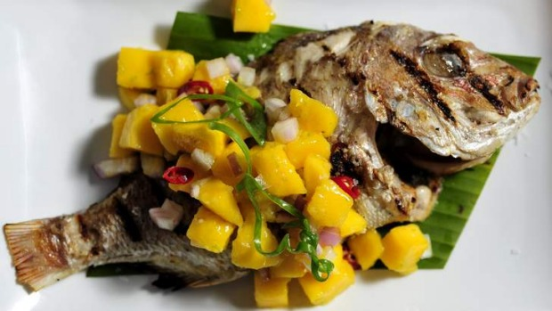 Baked whole baby snapper with mango Salsa from Kusina.