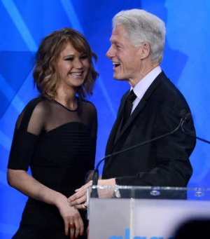 Former US president Bill Clinton with actor Jennifer Lawrence.