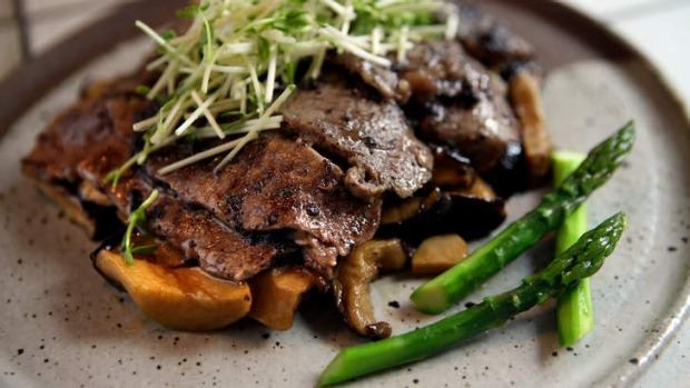 Wagyu oyster blade steak with mushrooms.