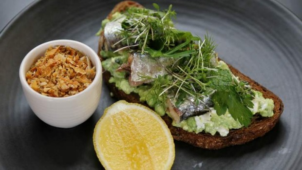 Sweet pea and feta smash on dark rye, with Spanish sardines.