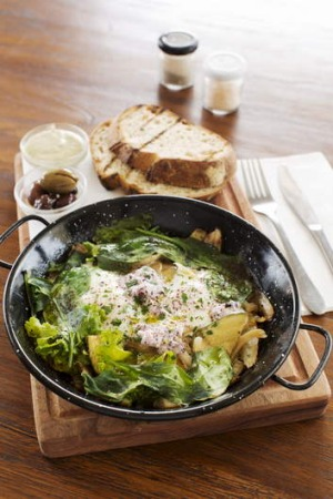 Green shakshuka with olives and grilled sourdough.