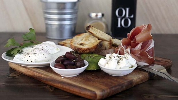 Altogether now: Italian brekkie board with two poached eggs, prosciutto, avocado, Persian feta and marinated olives ...