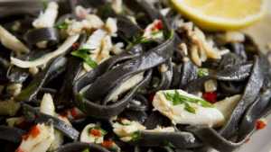 Squid ink fettuccine with crab and chilli.