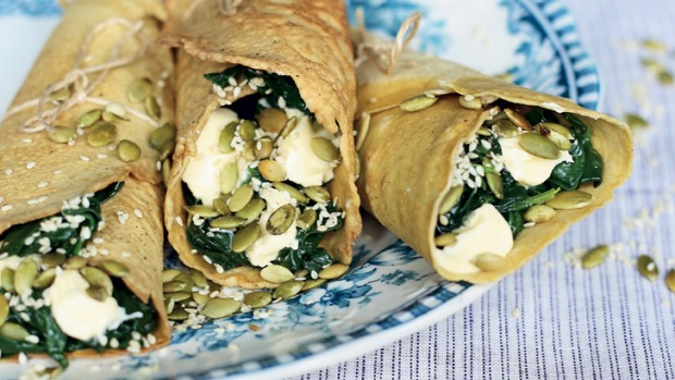 Almond flour crepes with ricotta, wilted greens and toasted seeds.