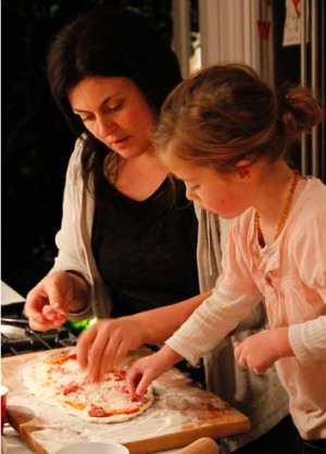 Karen Martini in the kitchen with her daughter Amber.