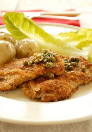 Serve the schnitzel with a side of boiled potatoes.