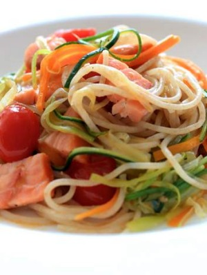 Spaghettini with hot-smoked salmon and vegetables.
