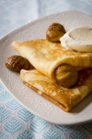 Drizzle chestnut syrup over the crepes and serve with a dollop of orange cream.
