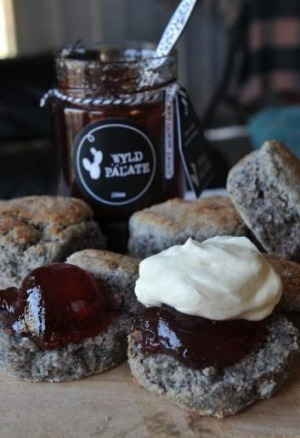 Blue-corn scones, topped with Wyld Palate guava jelly and cream.