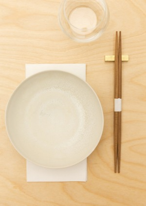 Cho Cho San features double-ended chopsticks and flashes of gold.