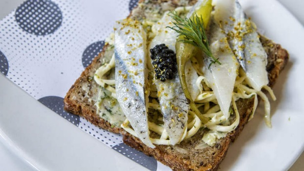 Pickled garfish smorrebrod scattered with herring roe.