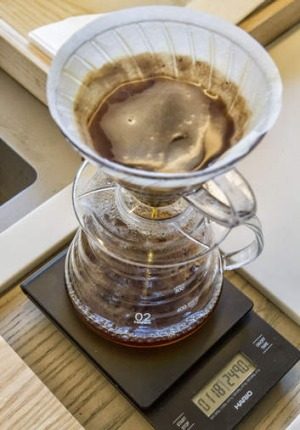 A pourover coffee is prepared at Filter.