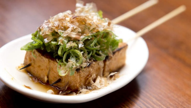 Deep-fried organic tofu with shallots and bonito flakes.