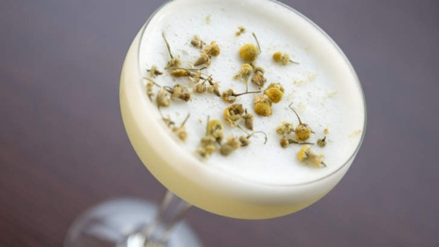 Bloomsbury Bouquet cocktail scattered with chamomile.