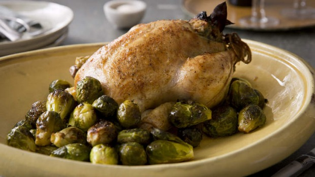 Brined and stuffed roast chicken with honeyed brussels sprouts. <b>Photo:</b> Marcel Aucar.