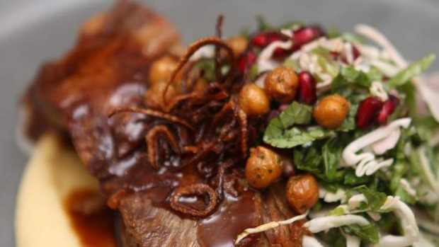 Slow-cooked lamb shoulder with pomegranate, sorrel and a lush chickpea puree.