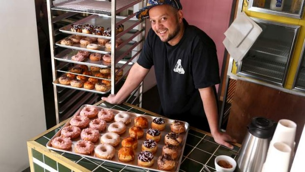 Raph Rashid with a tray of his fluffy doughnuts.
