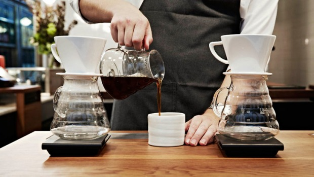 'It's not a secret science': A barista prepares pourover coffee.