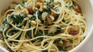 Spaghetti with silverbeet, raisins and pine nuts.