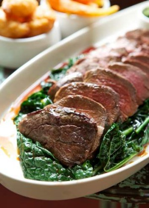 Roasted eye fillet on a bed of wilted cavolo nero.