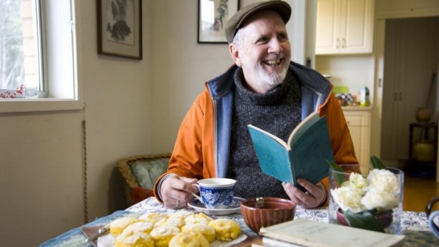 Greg Johnson with his early editions of <i>The Canberra Gardener</i> and home-made pumpkin scones.