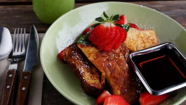 Brioche French toast and a green apple, pear, spinach cold-pressed juice.