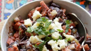 Refried red beans with chorizo.