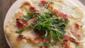 Pizza with taleggio, prosciutto and pear.