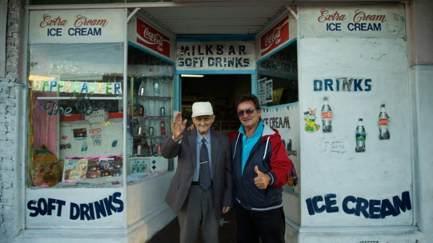 George Poulos, 90, with his son Nik, has owned the Rio milk bar in Summer Hill since 1952.