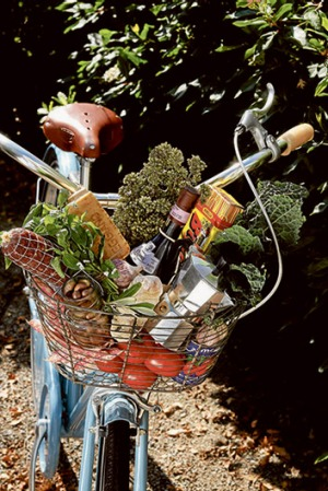 A bicycle basket laden with Finnish foodstuffs.