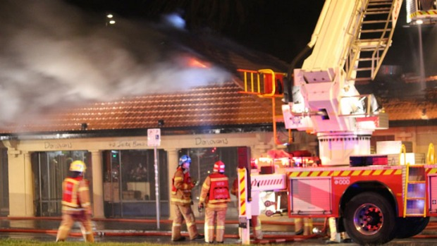 Fire fighters battle the blaze at Donovans restaurant.
