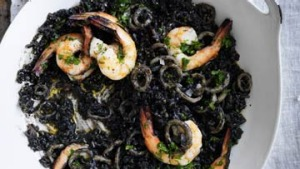 Paint it black: Prawn, squid ink and bacon paella.