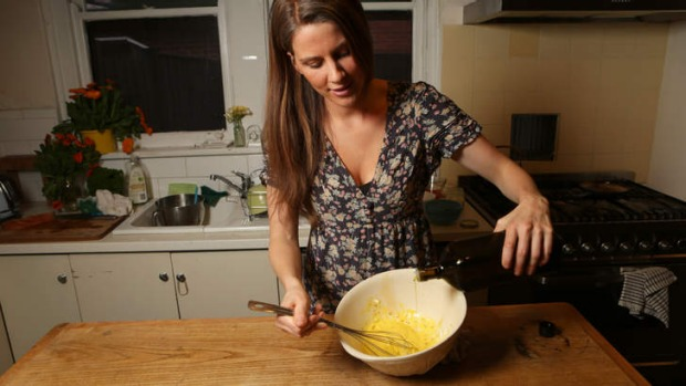 Arabella Forge whisks ingredients for creamy apple cider vinegar dressing.