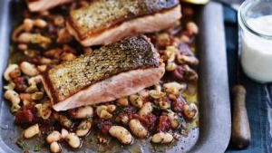 Crispy skin salmon with braised white beans.