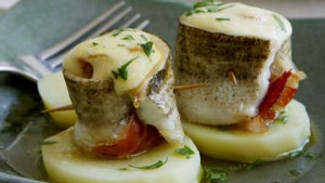 Baked whiting with jamon and garlic mayonnaise.
