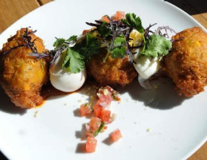 The corn fritters with poached egg at Addict Food and Coffee, Fitzroy.