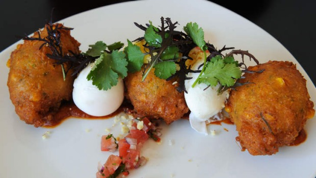 Corn fritters with kasoundi and poached eggs.