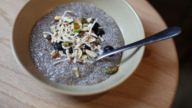 Chia pudding topped with shredded coconut and nuts.