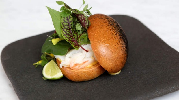 Charcoal-smeared brioche bun on Kettle Black's lobster roll in Melbourne.