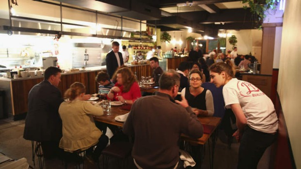 Meat and smoke: Share tables and an open kitchen feature at LP's.