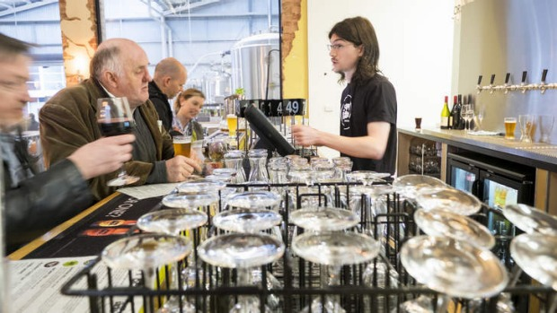 Industrial chic: Food is served among the brewing equipment.