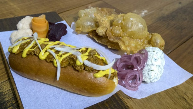 Signature dishes: The gribenes (fried chicken skins) and smoked hotdog.