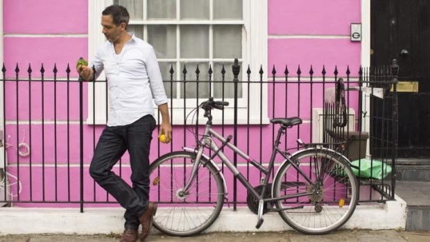 Yotam Ottolenghi outside his test kitchen in Camden Town, London. The kitchen doubles as an office and is the heart of ...