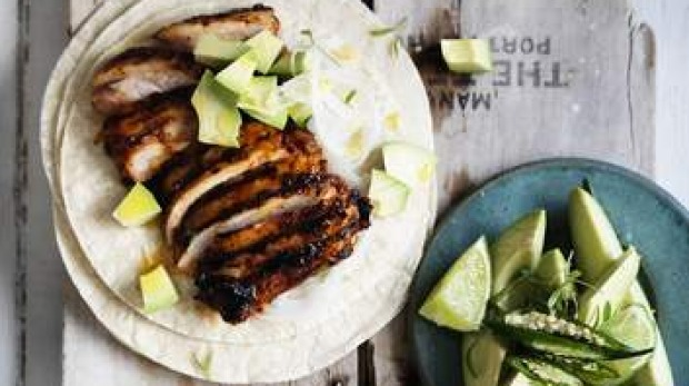 Neil Perry's adobo-marinated chicken tacos. Photo: William Meppem