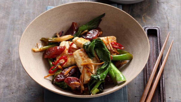 Wok-fried fish with lap cheong, chilli and ginger.