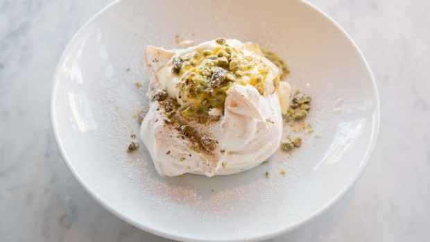 Pistachio pavlova with passionfruit and yoghurt cream.